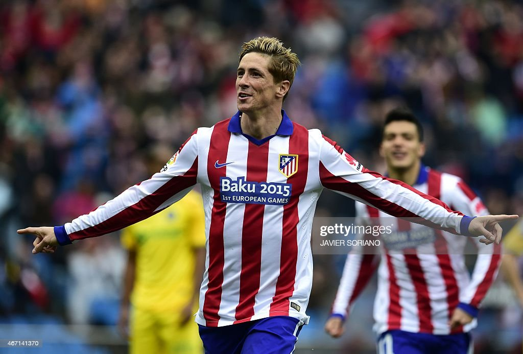 Atletico Madrid's forward Fernando Torres celebrates after scoring a goal during the Spanish league football match Club Atletico de Madrid vs Getafe CF at the Vicente Calderon stadium in Madrid on March 21, 2015.