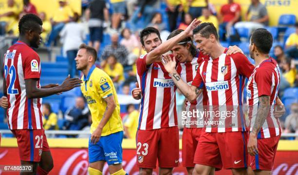 Atletico Madrid's forward Fernando Torres celebrates with teammates after scoring during the Spanish league football match UD Las Palmas vs Club...