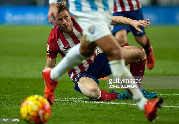 Atletico Madrid's forward Fernando Torres looks at the ball during the Spanish league football match Malaga CF vs Club Atletico de Madrid at La...