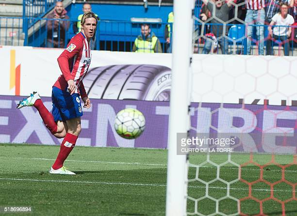 Atletico Madrid's forward Fernando Torres scores during the Spanish league football match Club Atletico de Madrid vs Real Betis Balompi at the...