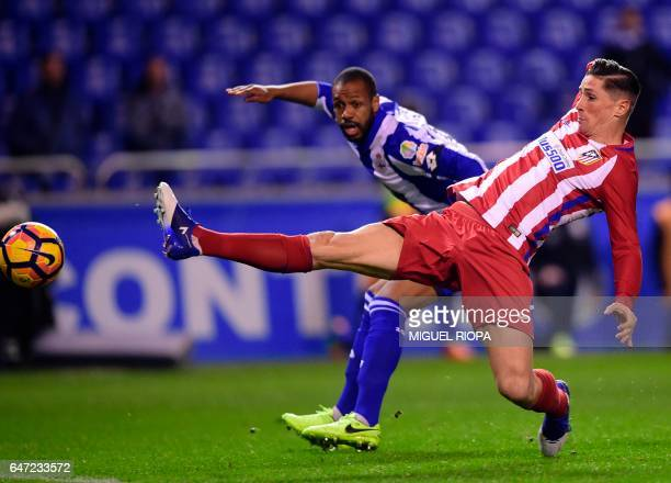 TOPSHOT Atletico Madrid's forward Fernando Torres vies with Deportivo La Coruna's Brazilian defender Sidnei during the Spanish league football match...