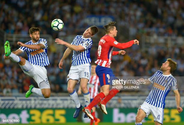 Atletico Madrid's forward Fernando Torres vies with Real Sociedad's Spanish defender Aritz Elustondo during the Spanish league football match Real...