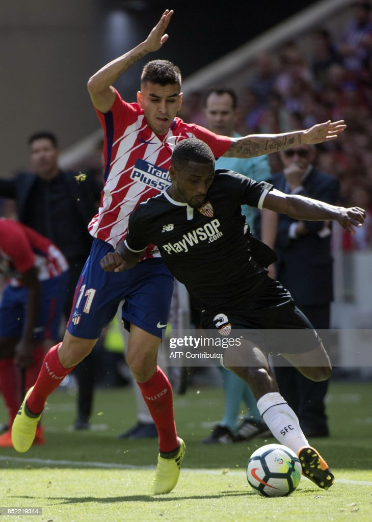 Atletico Madrid's forward from Argentina Angel Correa (L) vies with Sevilla's defender from France Lionel Carole during the Spanish league football match Club Atletico de Madrid vs Sevilla FC at the Wanda Metropolitano stadium in Madrid on September 23, 2017. /