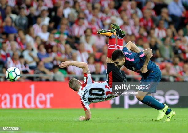 Atletico Madrid's forward from Argentina Angel Correa vies with Athletic's forward Iker Muniain during the Spanish league football match Athletic...