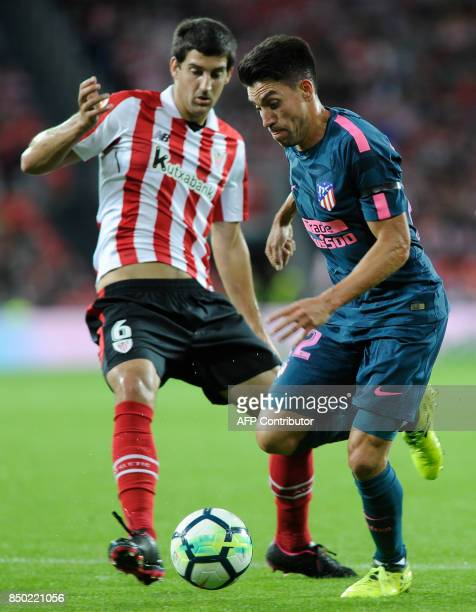 Atletico Madrid's forward from Argentina Angel Correa vies with Athletic's midfielder Mikel San Jose during the Spanish league football match...