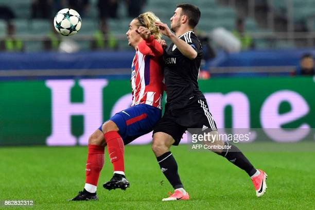 Atletico Madrid's forward from France Antoine Griezmann and Qarabag's defender from Azerbaijan Gara Garayev vie for the ball during the UEFA...
