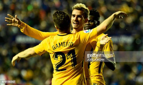 Atletico Madrid's forward from France Antoine Griezmann celebrate with Atletico Madrid's French forward Kevin Gameiro after scoring during the...
