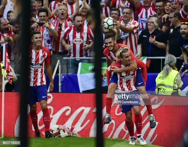 Atletico Madrid's forward from France Antoine Griezmann celebrates a goal with Atletico Madrid's midfielder from Spain Koke during the Spanish league...