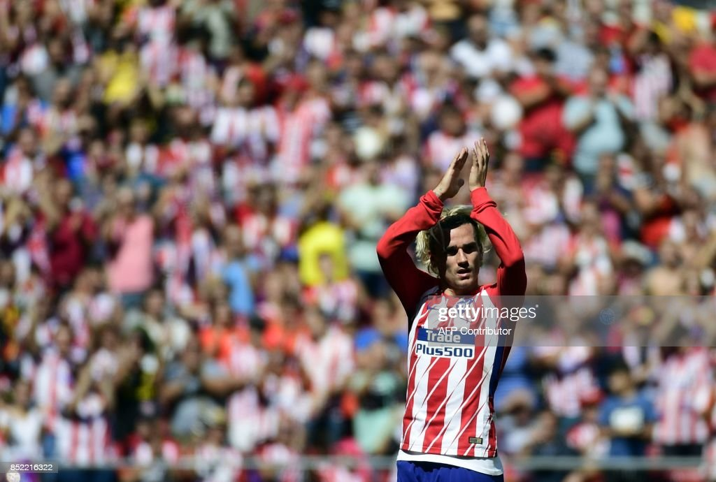 Atletico Madrid's forward from France Antoine Griezmann celebrates a goal during the Spanish league football match Club Atletico de Madrid vs Sevilla FC at the Wanda Metropolitano stadium in Madrid on September 23, 2017. /