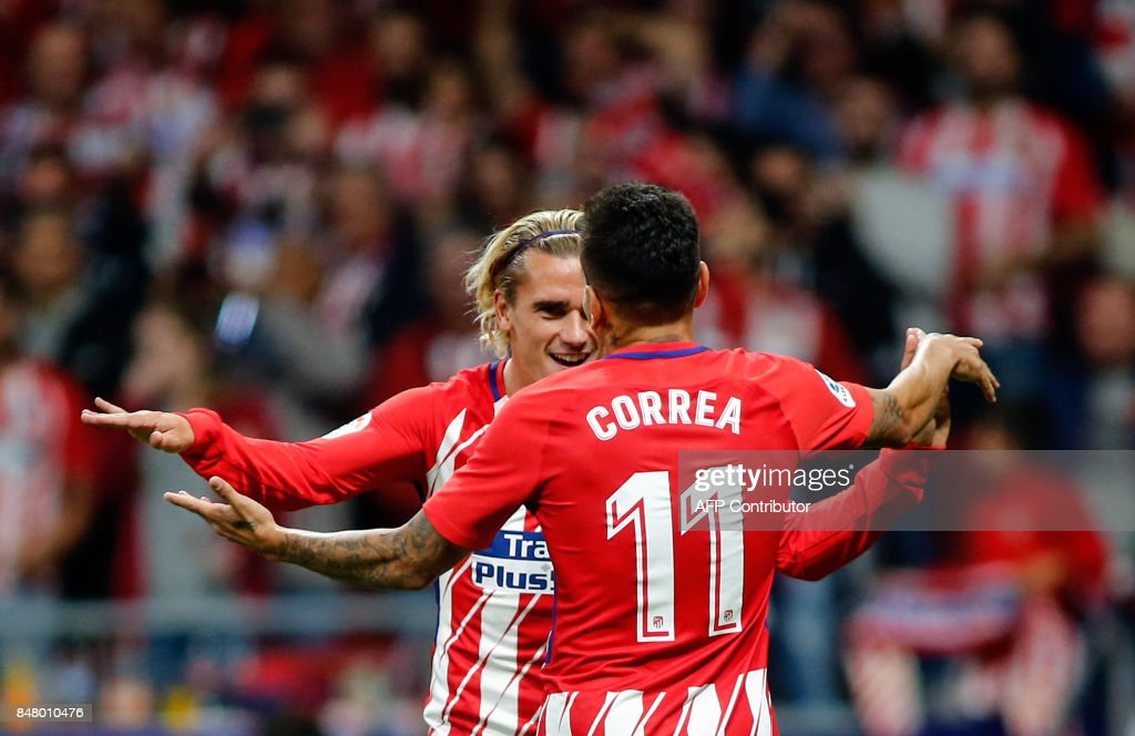 Atletico Madrid's forward from France Antoine Griezmann (L) celebrates with Atletico Madrid's forward from Argentina Angel Correa (R) after scoring during the Spanish league football match Club Atletico de Madrid vs Malaga CF at the Wanda Metropolitano stadium in Madrid on September 16, 2017. /