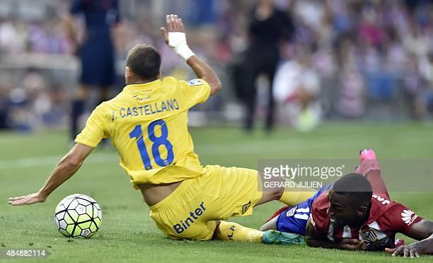 Atletico Madrid's forward Jackson M vies with Las Palmas' midfielder Javi Castellano during the Spanish league football match Club Atletico de Madrid...