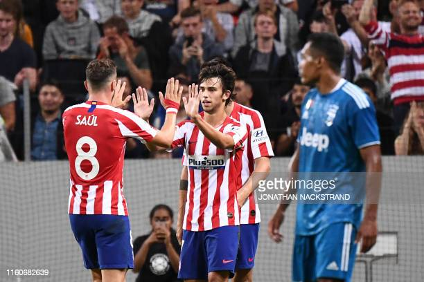 Atletico Madrid's forward Joao Felix celebrates with his teammates after scoring during the International Champions Cup football match between...