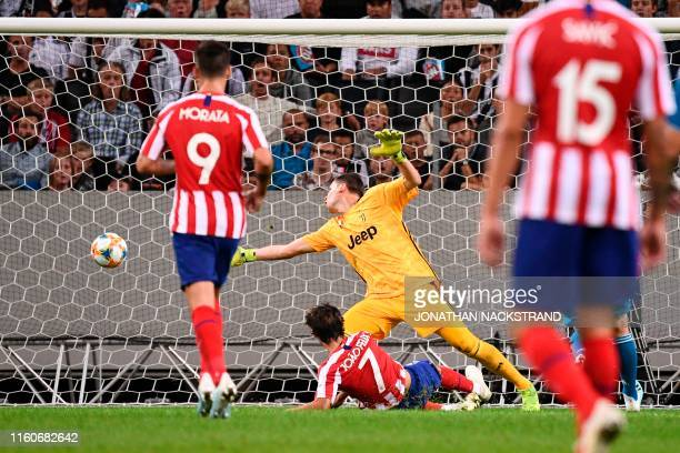 Atletico Madrid's forward Joao Felix shoots to score past Juventus' goalkeeper Wojciech Tomasz Szczesny during the International Champions Cup...