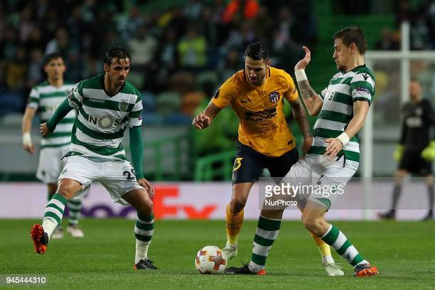 Atletico Madrids forward Vitolo of Spain vies with Sporting's forward Bryan Ruiz from Costa Rica and Sporting's defender Sebastian Coates from...