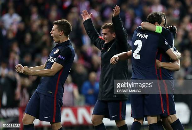 Atletico Madrid's French defender Lucas Hernandez and teammates celebrate their win during the Champions League quarter-final second leg football...