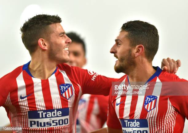 Atletico Madrid's French defender Lucas Hernandez is congratulated by teammate Atletico Madrid's Spanish midfielder Koke after scoring a goal during...