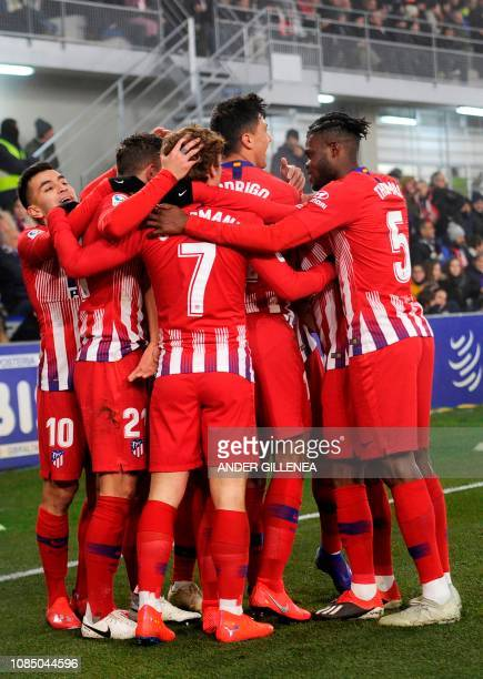Atletico Madrid's French defender Lucas Hernandez is congratulated by teammates after scoring a goal during the Spanish League football match between...