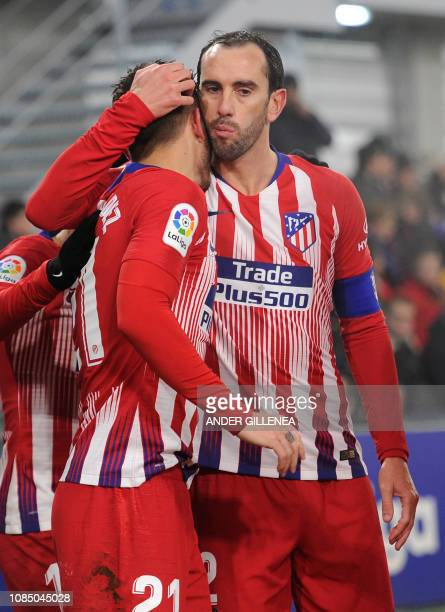 Atletico Madrid's French defender Lucas Hernandez is congratulated by teammate Atletico Madrid's Uruguayan defender Diego Godin after scoring a goal...