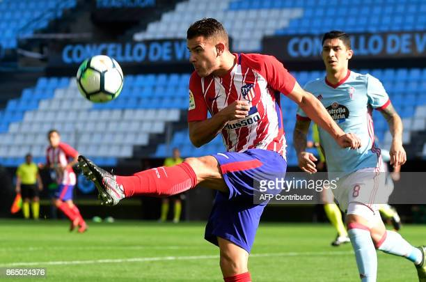 Atletico Madrid's French defender Lucas Hernandez kicks the ball next to Celta Vigo's Chilean midfielder Pablo Hernandez during the Spanish league...