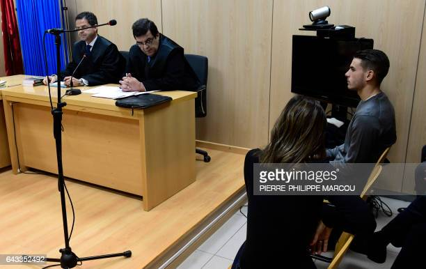 Atletico Madrid's French defender Lucas Hernandez sits at the courtroom of the Madrid's Criminal Court Nr 35 which specialises in domestic violence...
