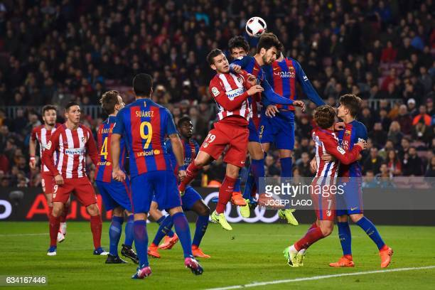 Atletico Madrid's French defender Lucas Hernandez vies with Barcelona's Portuguese midfielder Andre Gomes during the Spanish Copa del Rey semi final...
