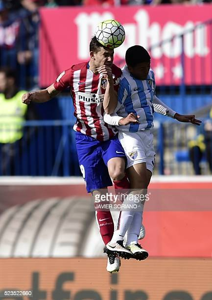 Atletico Madrid's French defender Lucas Hernandez vies with Malaga's Moroccan midfielder Noureddine Amrabat during the Spanish league football match...