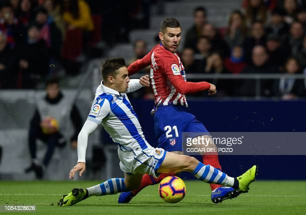 Atletico Madrid's French defender Lucas Hernandez vies with Real Sociedad's Spanish defender Andoni Gorosabel during the Spanish league football...