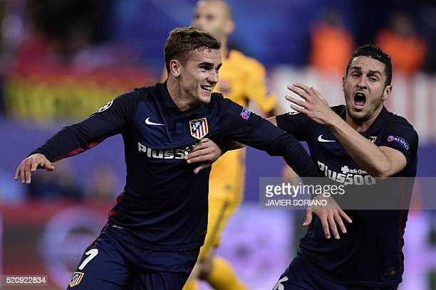 Atletico Madrid's French forward Antoine Griezmann and Atletico Madrid's midfielder Koke celebrate after scoring a goal during the Champions League...