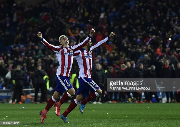 Atletico Madrid's French forward Antoine Griezmann and Atletico Madrid's defender Juanfran celebrate after defeating Bayer Leverkusen at the end of...