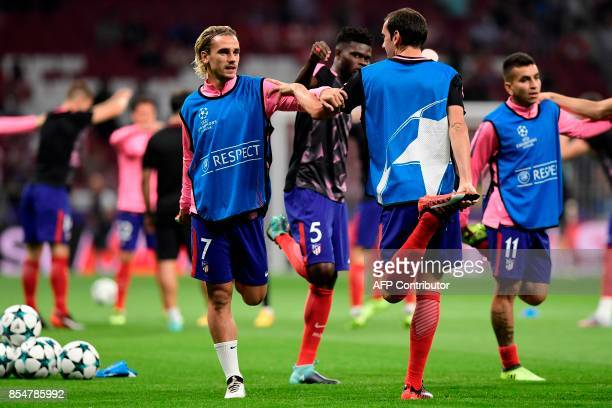 Atletico Madrid's French forward Antoine Griezmann and Atletico Madrid's Uruguayan defender Diego Godin stretch before the UEFA Champions League...