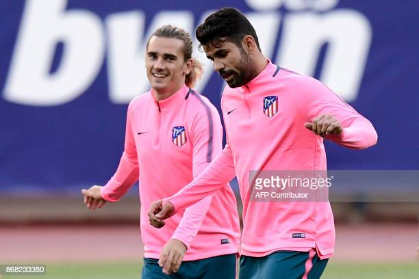 Atletico Madrid's French forward Antoine Griezmann and Atletico Madrid's Spanish forward Diego Costa take part in a training session at the Vicente...