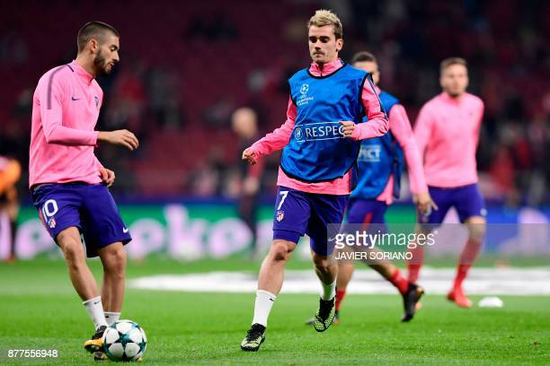 Atletico Madrid's French forward Antoine Griezmann and Atletico Madrid's Belgian midfielder Yannick FerreiraCarrasco warm up ahead of the UEFA...