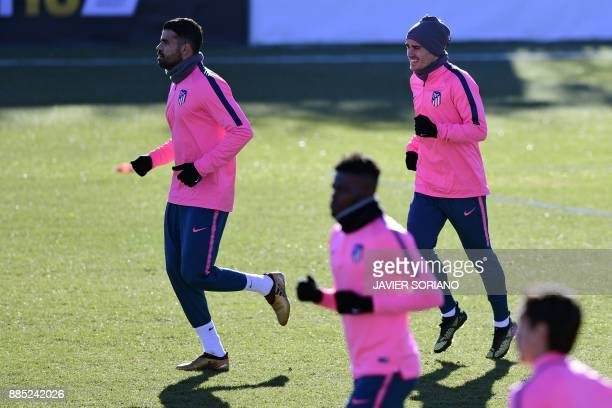 Atletico Madrid's French forward Antoine Griezmann and Atletico Madrid's SpanishBrazilian forward Diego Costa take part in a training session at...