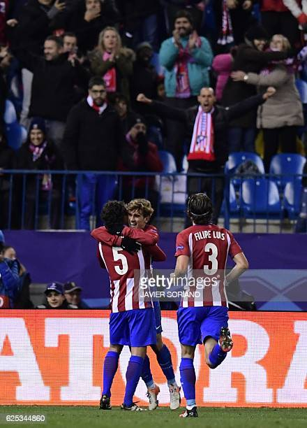 Atletico Madrid's French forward Antoine Griezmann and teammates celebrate after scoring a goal during the UEFA Champions League Group D football...