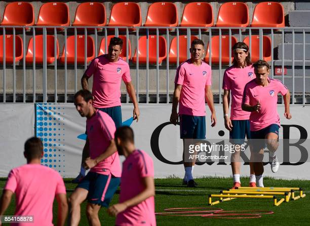 Atletico Madrid's French forward Antoine Griezmann and teammates take part in a training session at the Wanda Metropolitano stadium in Madrid on...