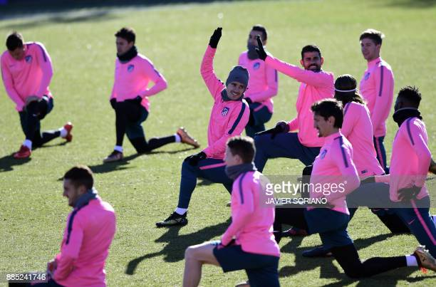 Atletico Madrid's French forward Antoine Griezmann and teammates take part in a training session at Atletico de Madrid's sport city in Majadahonda...