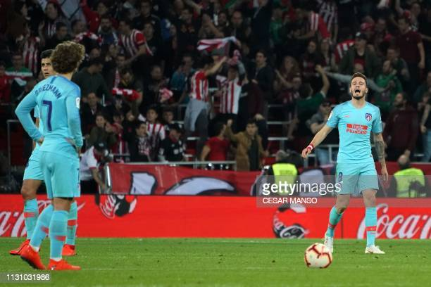 Atletico Madrid's French forward Antoine Griezmann argues with Atletico Madrid's Spanish midfielder Saul Niguez following Athletic's goal during the...
