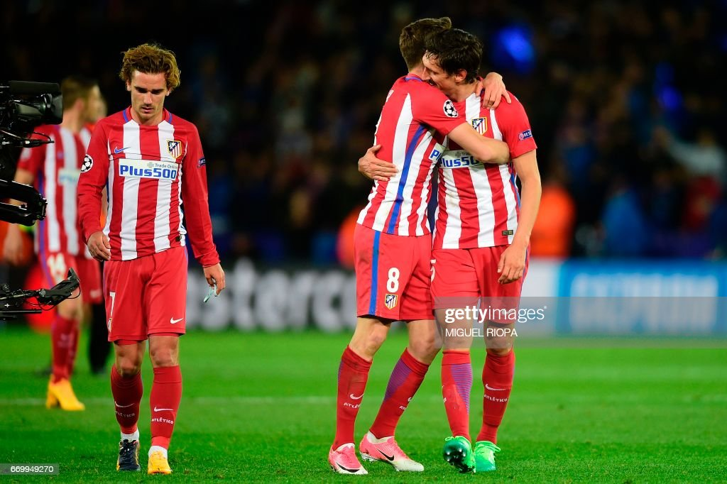 Atletico Madrid's French forward Antoine Griezmann, Atletico Madrid's Spanish midfielder Saul Niguez and Atletico Madrid's Montenegrin defender Stefan Savic react following the UEFA Champions League quarter-final second leg football match between Leicester City and Club Atletico de Madrid at the King Power stadium in Leicester on April 18, 2017. The match ended in a draw at 1-1, with Atletico Madrid winning on aggregate at 2-1. /