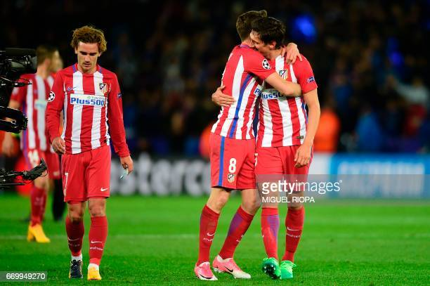 Atletico Madrid's French forward Antoine Griezmann Atletico Madrid's Spanish midfielder Saul Niguez and Atletico Madrid's Montenegrin defender Stefan...