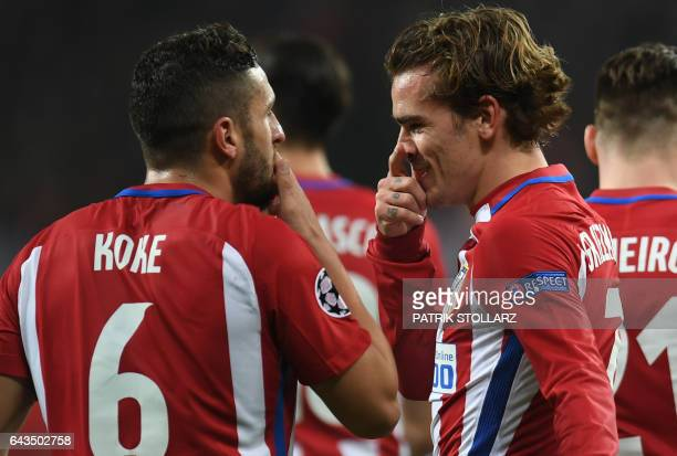 Atletico Madrid's French forward Antoine Griezmann celebrate after scoring the 02 goal with his teammate Koke during the UEFA Champions League round...