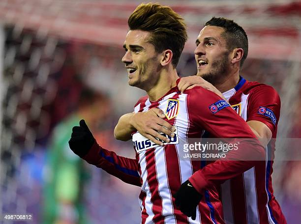 Atletico Madrid's French forward Antoine Griezmann celebrates a goal with Atletico Madrid's midfielder Koke during the UEFA Champions League Group C...