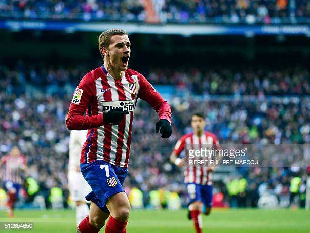 Atletico Madrid's French forward Antoine Griezmann celebrates a goal during the Spanish league football match Real Madrid CF vs Club Atletico de...