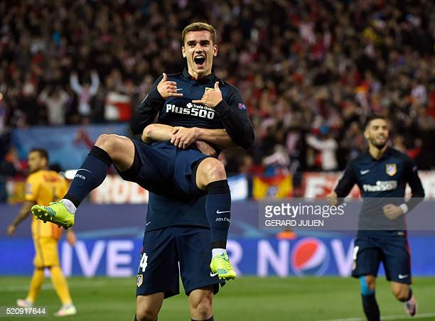 TOPSHOT Atletico Madrid's French forward Antoine Griezmann celebrates a goal during the Champions League quarterfinal second leg football match Club...