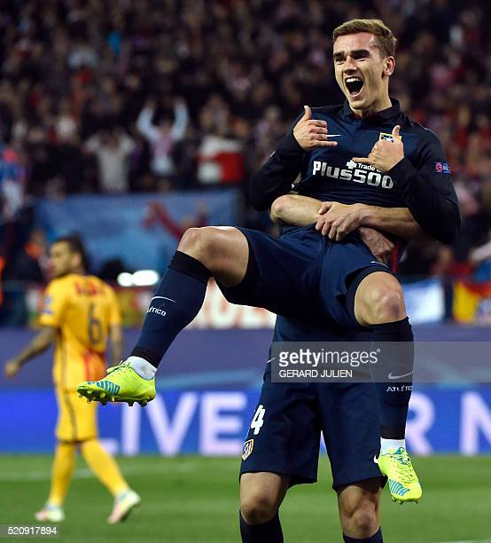 Atletico Madrid's French forward Antoine Griezmann celebrates a goal with Atletico Madrid's midfielder Gabi during the Champions League quarterfinal...