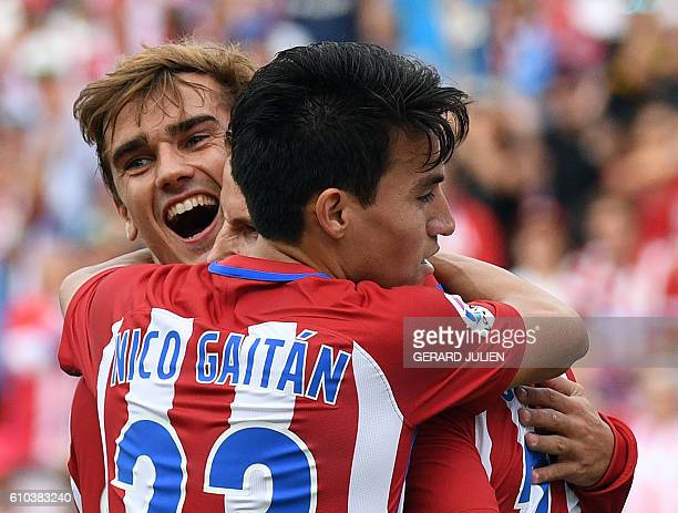 Atletico Madrid's French forward Antoine Griezmann celebrates a goal with Atletico Madrid's Argentinian midfielder Nicolas Gaitan during the Spanish...