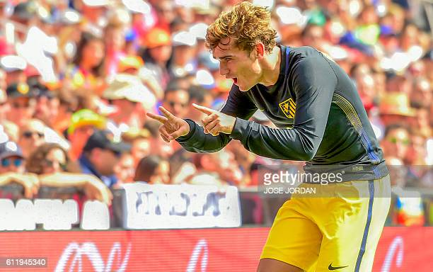 TOPSHOT Atletico Madrid's French forward Antoine Griezmann celebrates a goal during the Spanish league football match Valencia FC vs Club Atletico de...