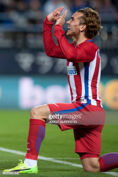 Atletico Madrid's French forward Antoine Griezmann celebrates a goal during the Spanish league football match Malaga CF vs Club Atletico de Madrid at...