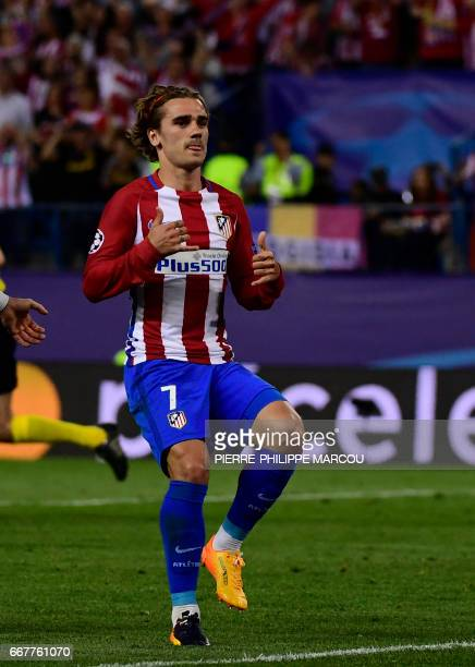 Atletico Madrid's French forward Antoine Griezmann celebrates a penalty goal during the UEFA Champions League quarter final first leg football match...