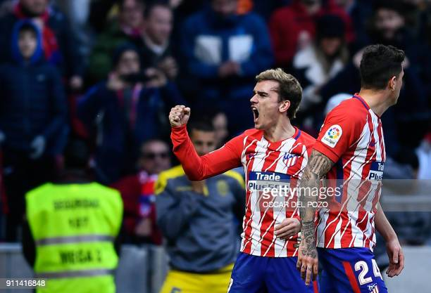 Atletico Madrid's French forward Antoine Griezmann celebrates a goal during the Spanish league football match between Club Atletico de Madrid and UD...