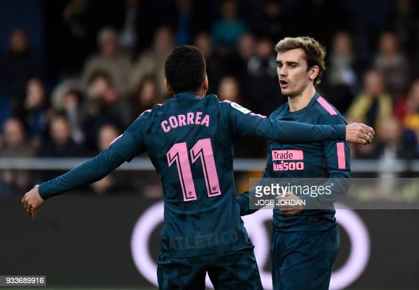 Atletico Madrid's French forward Antoine Griezmann celebrates a goal with Atletico Madrid's Argentinian midfielder Angel Correa during the Spanish...